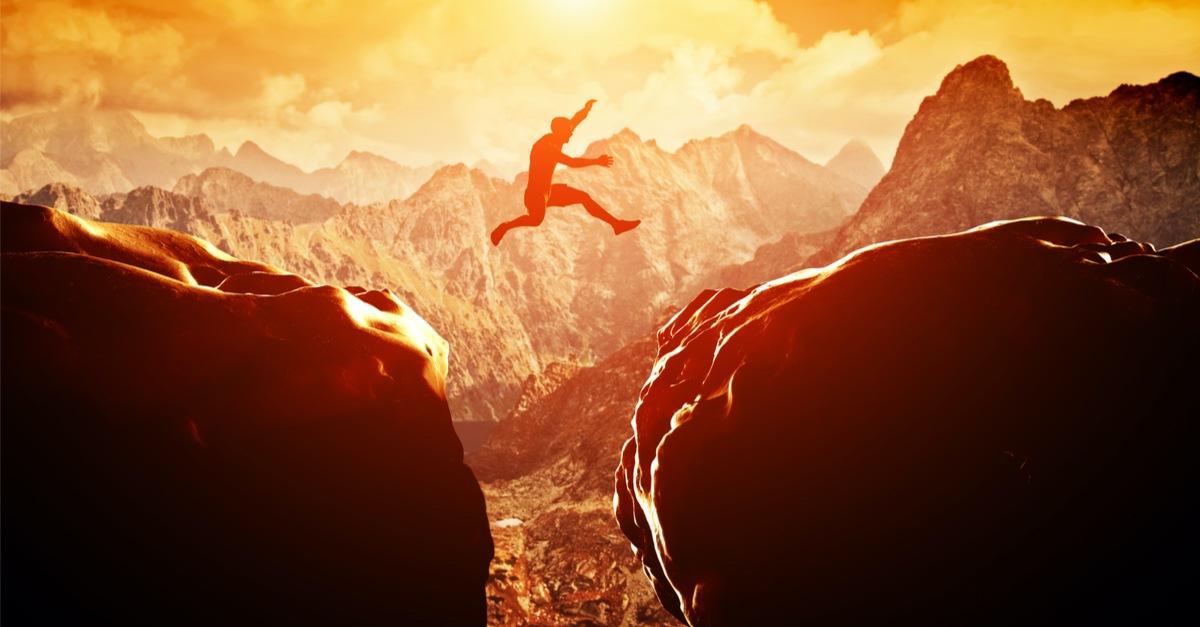 Man jumping a large gap